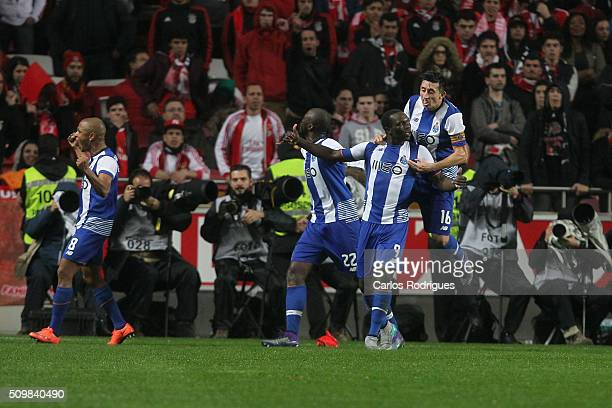 Porto's forward Vincent Aboubakar celebrates scoring Porto's second goal with his team mates during the match between SL Benfica and FC Porto for the...