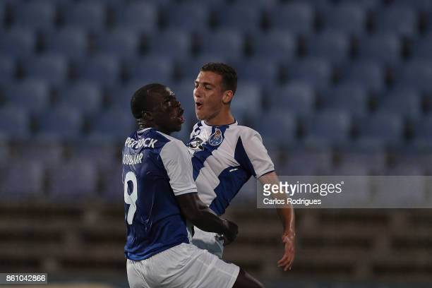 Porto's forward Vincent Aboubakar from Camaroes celebrates scoring Porto second goal with FC Porto's defender Diogo Dalot from Portugal during the...
