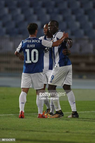 Porto's forward Vincent Aboubakar from Camaroes celebrates scoring Porto first goal with his team mates during the match between Lusitano Ginasio...