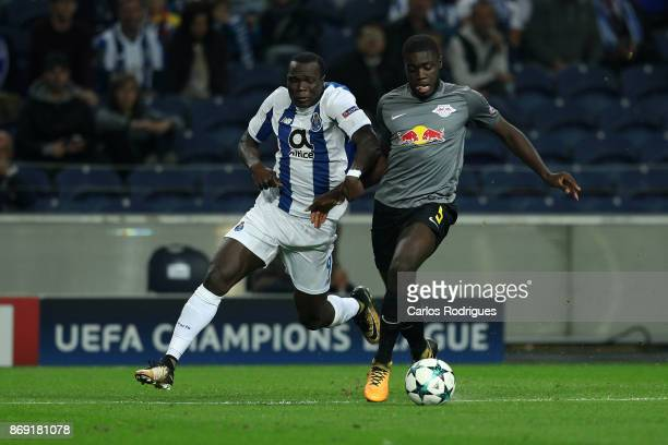 PortoÕs forward Vincent Aboubakar from Camaroes vies with Leipzig defender Dayot Upamecano from France for the ball possession during the match...