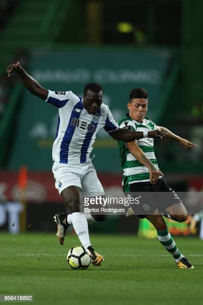 Porto's forward Vincent Aboubakar from Camaroes vies with Sporting CP defender Jonathan Silva from Argentina for the ball possession during the...