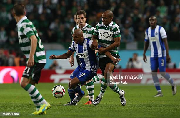 Porto's forward Yacine Brahimi with Sporting CP's midfielder Joao Mario in action during the Primeira Liga match between Sporting CP and FC Porto at...