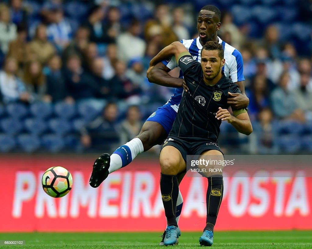 Porto's French defender Willy Boly (L) vies with Pacos de Ferreira's Brazilian forward Luiz Phellype during the Portuguese league football match FC Porto vs FC Pacos de Ferreira at the Dragao stadium in Porto on May 14, 2017. /