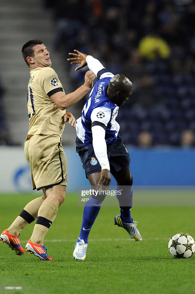 FC Porto's French defender,Eliaquim Mangala (R) vies with GNK Dinamo Zagreb's Montenegrin forward Fatos Becira during the UEFA Champions League group A football match FC Porto against GNK Dinamo Zagreb on November 21, 2012, at Dragao Stadium in Porto.