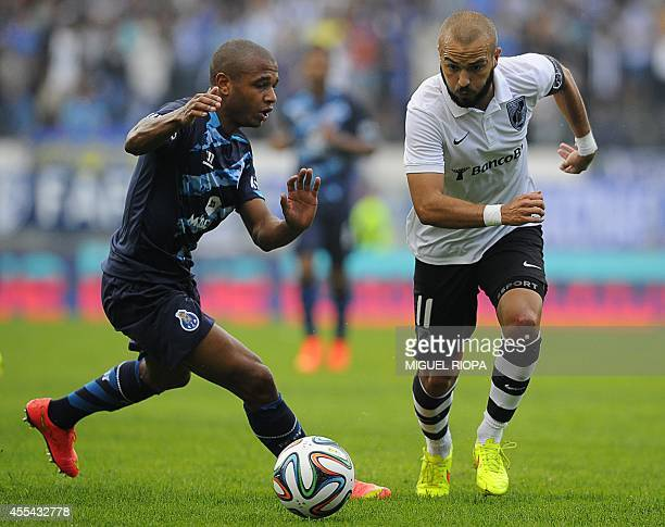 Porto's Frenchborn Algerian midfielder Yacine Brahimi vies with Vitoria SC's midfielder Andre Andre during the Portuguese league football match...