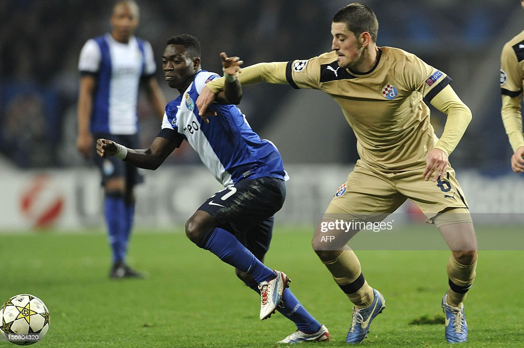 FC Porto's Ghanaian forward Christian Atsu (L) vies with GNK Dinamo Zagreb's Croatian midfielder Arijan Ademi (L) during the UEFA Champions League group A football match FC Porto against GNK Dinamo Zagreb on November 21, 2012, at Dragao Stadium in Porto.