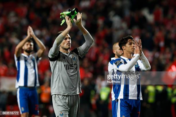 Porto's goalkeeper Iker Casillas and Porto's midfielder Oliver Torres applaud the supporters at the end of Premier League 2016/17 match between SL...