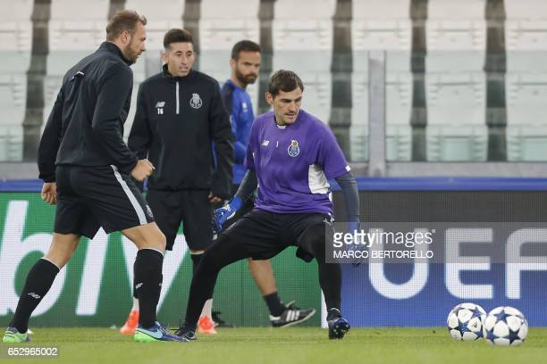 Porto's goalkeeper Iker Casillas from Spain and Porto's forward Laurent Depoitre from Belgium take part in a training session on the eve of the UEFA...