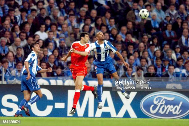 FC Porto's Juan Valeron and Deportivo La Coruna's Costinha battle for the ball in the air