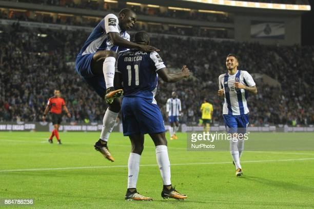 Porto's Malian forward Moussa Marega celebrates after scoring goal with teammate Porto's Cameroonian forward Vincent Aboubakar during the Premier...