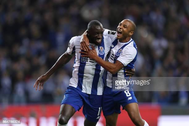 Porto's Malian forward Moussa Marega celebrates after scoring goal with teammate Porto's Algerian forward Yacine Brahimi during the Premier League...