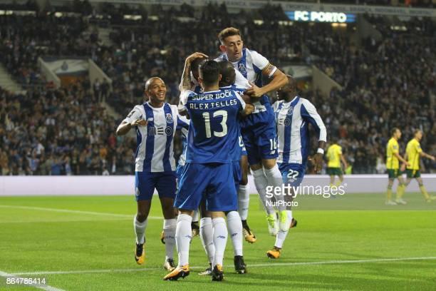 Porto's Malian forward Moussa Marega celebrates after scoring goal with teammates during the Premier League 2017/18 match between FC Porto and FC...