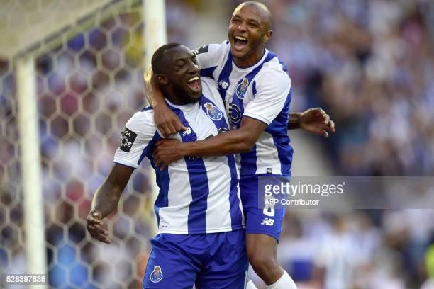 Porto's Malian forward Moussa Marega celebrates his second goal with teammate Algerian forward Yacine Brahimi during the Portuguese League football...