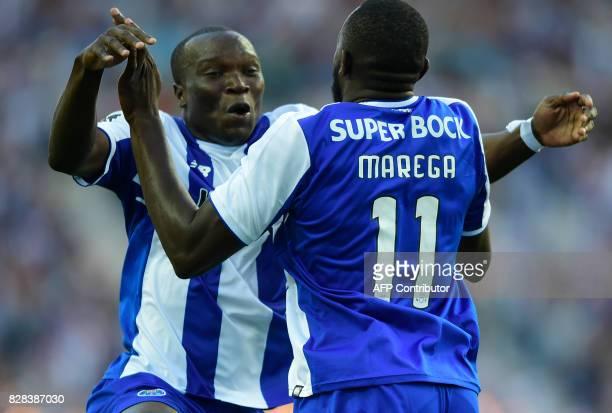 Porto's Malian forward Moussa Marega celebrates with teammate Cameroonian forward Vincent Aboubakar after scoring a goal during the Portuguese league...