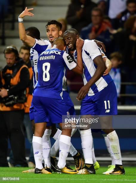 Porto's Malian forward Moussa Marega celebrates with teammates after scoring a goal during the Portuguese league football match FC Porto vs FC Pacos...