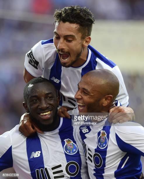 Porto's Malian forward Moussa Marega celebrates with teammates Algerian forward Yacine Brahimi and Brazilian defender Alex Telles after scoring his...