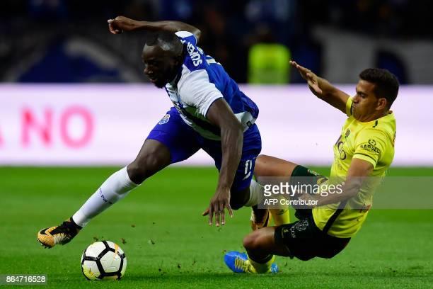 Porto's Malian forward Moussa Marega challenges Pacos de Ferreira's Brazilian midfielder Mateus Silva during the Portuguese league football match FC...