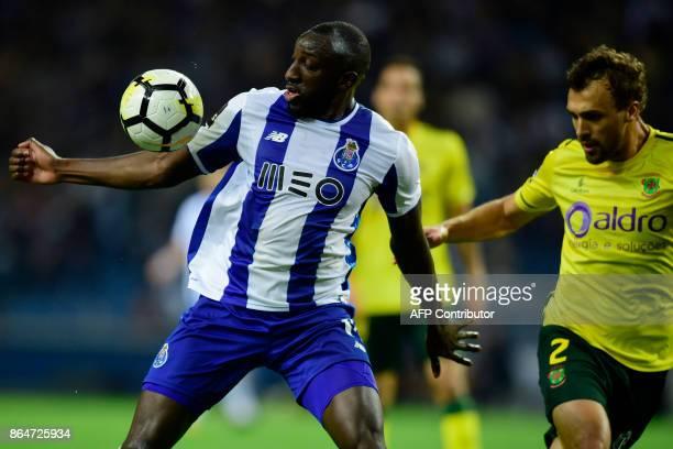 Porto's Malian forward Moussa Marega challenges Pacos de Ferreira's defender Marco Baixinho during the Portuguese league football match FC Porto vs...