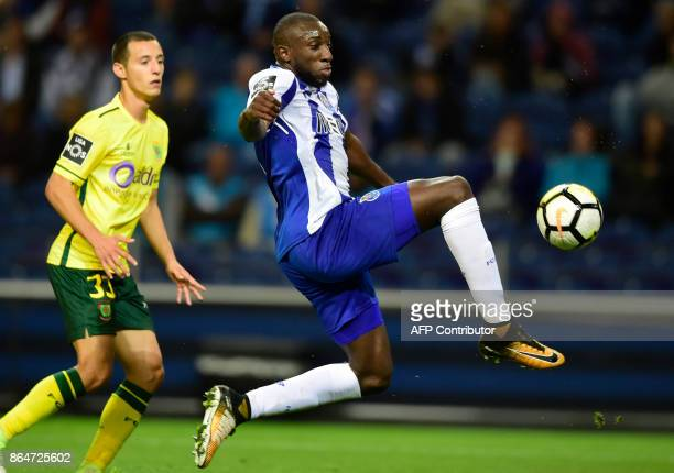 Porto's Malian forward Moussa Marega controls the ball next to Pacos de Ferreira's defender Francisco Afonso during the Portuguese league football...