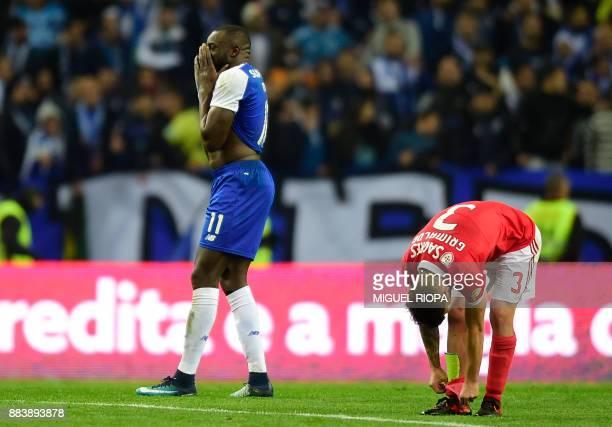 Porto's Malian forward Moussa Marega gestures beside Benfica's Spanish defender Alejandro Grimaldo at the end of the Portuguese league football match...