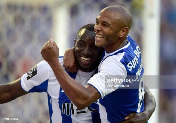 Porto's Malian forward Moussa Marega is congratulated by teammate Algerian forward Yacine Brahimi after scoring a goal during the Portuguese league...