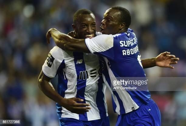 Porto's Malian forward Moussa Marega is congratulated by teammate Cameroonian forward Vincent Aboubakar after scoring a goal during the Portuguese...