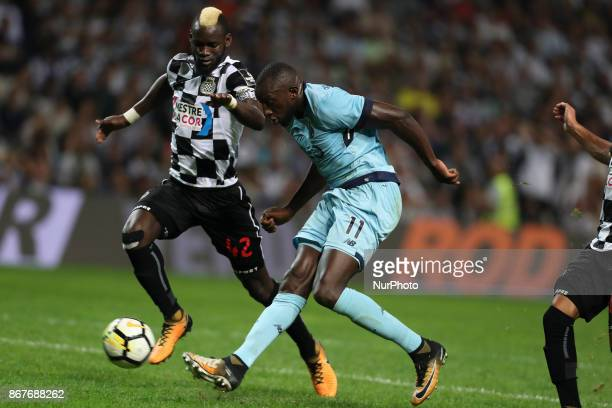 Porto's Malian forward Moussa Marega kick for goal during the Premier League 2017/18 match between Boavista FC and FC Porto at Bessa XXI Stadium in...