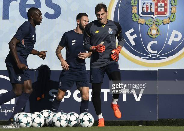 Porto's Malian forward Moussa Marega Mexican defender Miguel Layun and Spanish goalkeeper Iker Casillas take part in a training session at the Olival...