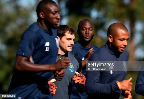 Porto's Malian forward Moussa Marega Spanish goalkeeper Iker Casillas Portuguese midfielder Danilo Pereira and Algerian forward Yacine Brahimi take...