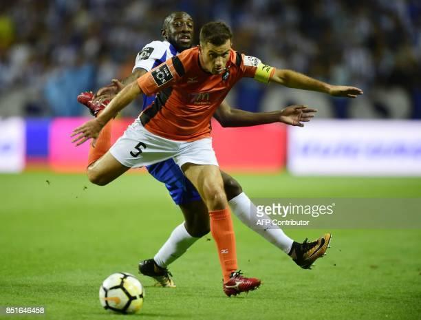 Porto's Malian forward Moussa Marega vies with Portimonense's defender Ricardo Pessoa during the Portuguese league football match FC Porto vs...