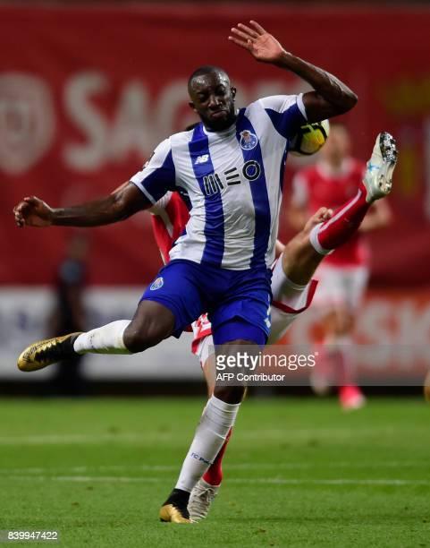 Porto's Malian forward Moussa Marega vies with Sporting Braga's Montenegrin midfielder Nikola Vukcevic during the Portuguese league football match...