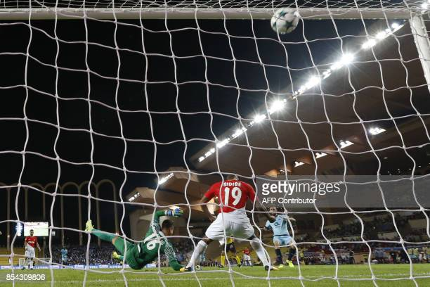 Porto's Mexican defender Miguel Layun scores a goal during the UEFA Champions League Group G football match AS Monaco FC vs FC Porto on September 26...