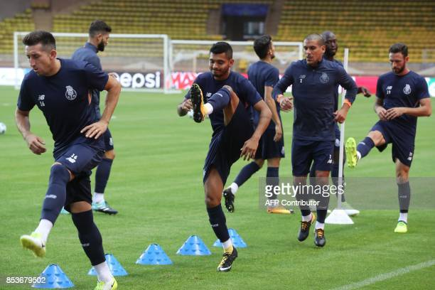Porto's Mexican forward Jesus Corona and his teammates attend a training session at the 'Louis II' stadium on the eve of their UEFA Champions League...