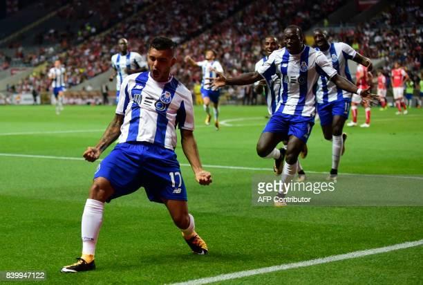 Porto's Mexican forward Jesus Corona celebrates after scoring during the Portuguese league football match Sporting Clube de Braga vs FC Porto at the...