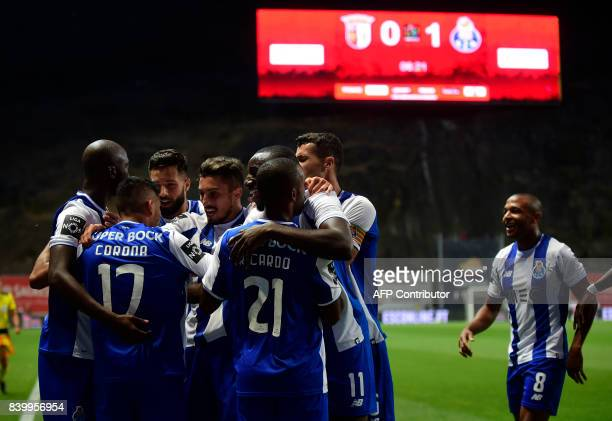 Porto's Mexican forward Jesus Corona celebrates with teammates after scoring during the Portuguese league football match Sporting Clube de Braga vs...