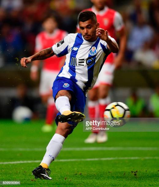Porto's Mexican forward Jesus Corona kicks the ball to score during the Portuguese league football match Sporting Clube de Braga vs FC Porto at the...