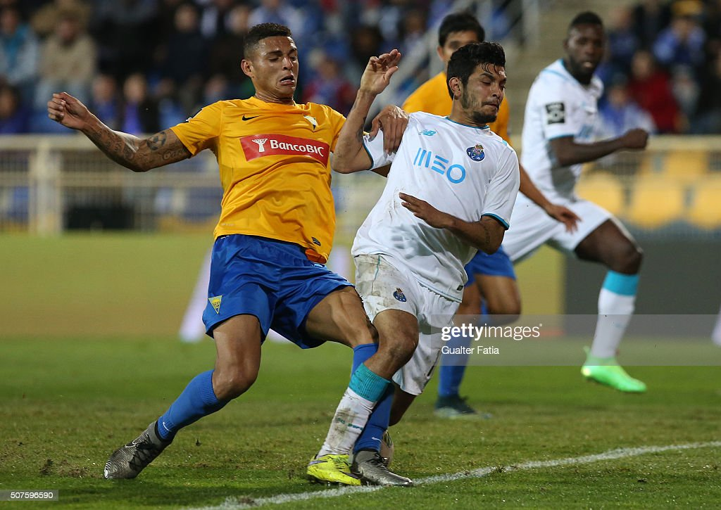 FC Porto's mexican forward Jesus Corona tackled by GD Estoril Praia's defender Diego Carlos during the Primeira Liga match between GD Estoril Praia and FC Porto at Estadio Antonio Coimbra da Mota on January 30, 2016 in Estoril, Portugal.