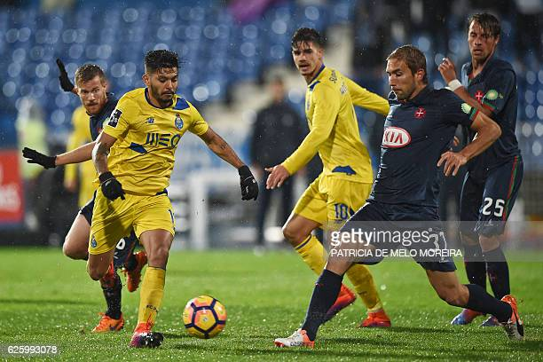 Porto's Mexican forward Jesus Corona vies with Belenenses' defender Goncalo Silva during the Portuguese league football match OS Belenenses vs FC...