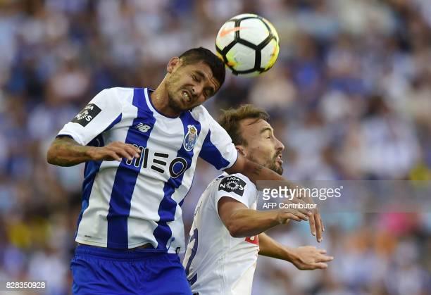 Porto's Mexican forward Jesus Corona vies with Estoril's forward Andre Claro during the Portuguese league football match FC Porto vs Estoril Praia at...