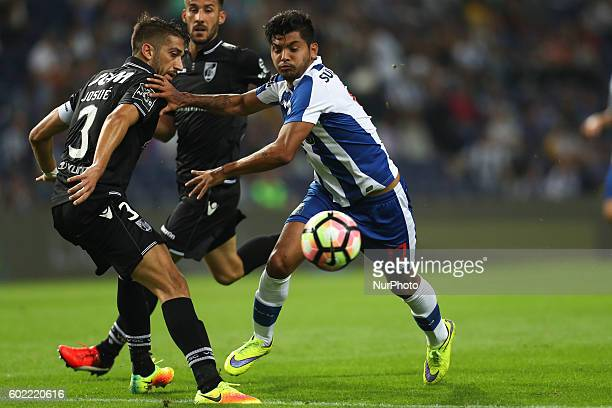 Porto's Mexican forward Jesus Corona vies with Vitoria SC's Portuguese defender Josue Sa during the Premier League 2016/17 match between FC Porto and...