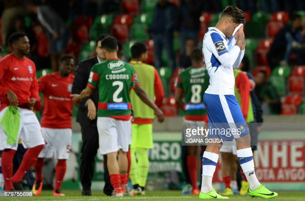 Porto's Mexican forward Jesus Corona wipes his face as he leaves the field at the end of the Portuguese league football match CS Maritimo vs FC Porto...