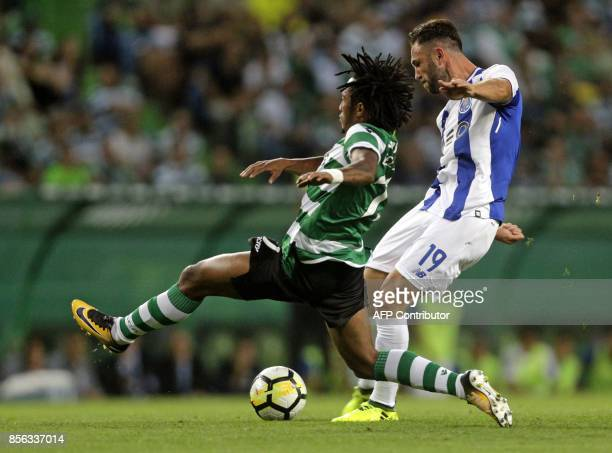 Porto's Mexican forward Miguel Layun challenges Sporting's midfielder Gelson Martins during the Portuguese league football match Sporting CP vs FC...