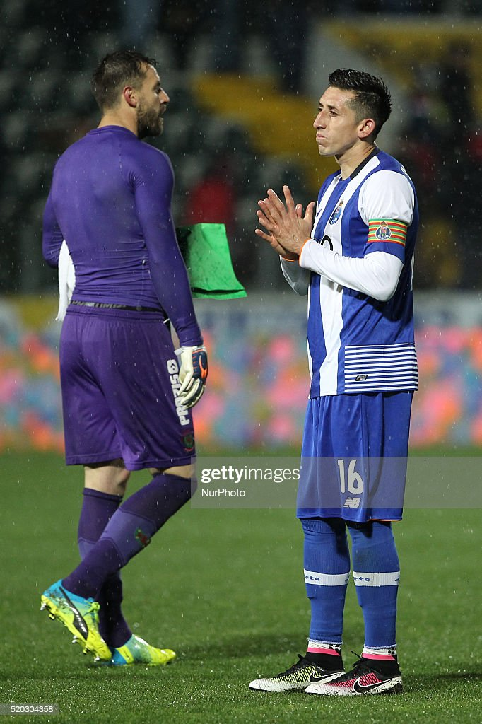 Porto's Mexican midfielder Héctor Herrera (R) reacts after end of game during the Premier League match between Pacos Ferreira and FC Porto, at Mata Real Stadium in Paços de Ferreira on April 10, 2016.