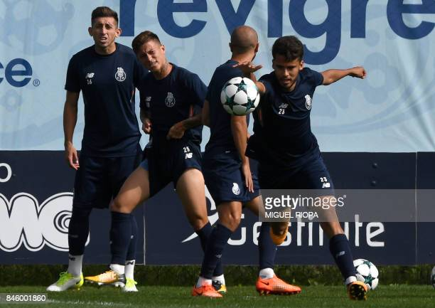 Porto's Mexican midfielder Hector Herrera Brazilian midfielder Otavio midfielder Andre Andre and Mexican defender Diego Reyes attend a training...