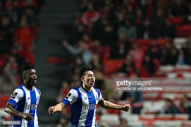 Porto's Mexican midfielder Hector Herrera celebrates a goal with teammate Porto's Nigerian midfielder Chidozie Awaziem during the Portuguese league...