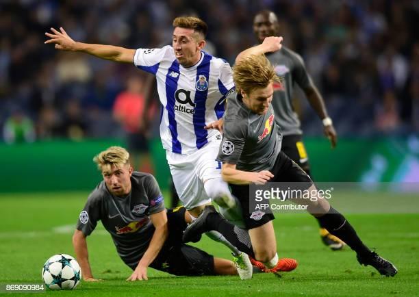 Porto's Mexican midfielder Hector Herrera challenges Leipzig's Slovenian midfielder Kevin Kampl and Leipzig's Swedish midfielder Emil Forsberg during...