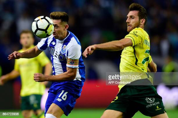 Porto's Mexican midfielder Hector Herrera challenges Pacos de Ferreira's defender Miguel Vieira during the Portuguese league football match FC Porto...