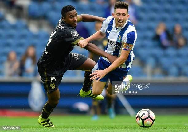 Porto's Mexican midfielder Hector Herrera is tackled by Pacos de Ferreira's Cape Verdean defender Gege during the Portuguese league football match FC...