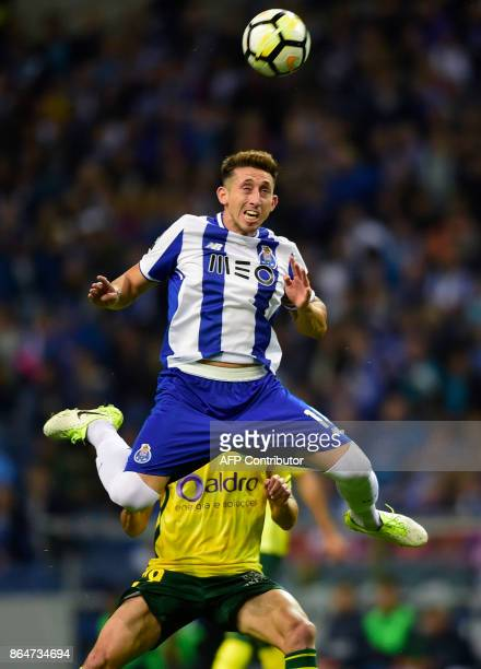 Porto's Mexican midfielder Hector Herrera jumps for a header during the Portuguese league football match FC Porto vs FC Pacos de Ferreira at the...