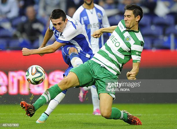 Porto's Mexican midfielder Hector Herrera kicks the ball next toSporting's defender Paulo Oliveira during the Portugal's Cup football match FC Porto...